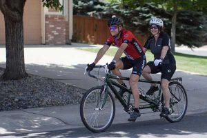 Debi Saidman-Ireland and husband on bike